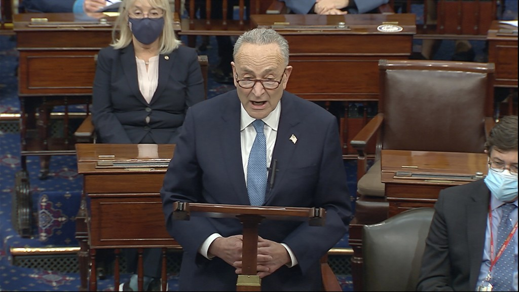 In this image from video, Senate Minority Leader Chuck Schumer of N.Y., speaks as the Senate reconvenes after protesters stormed into the U.S. Capitol...