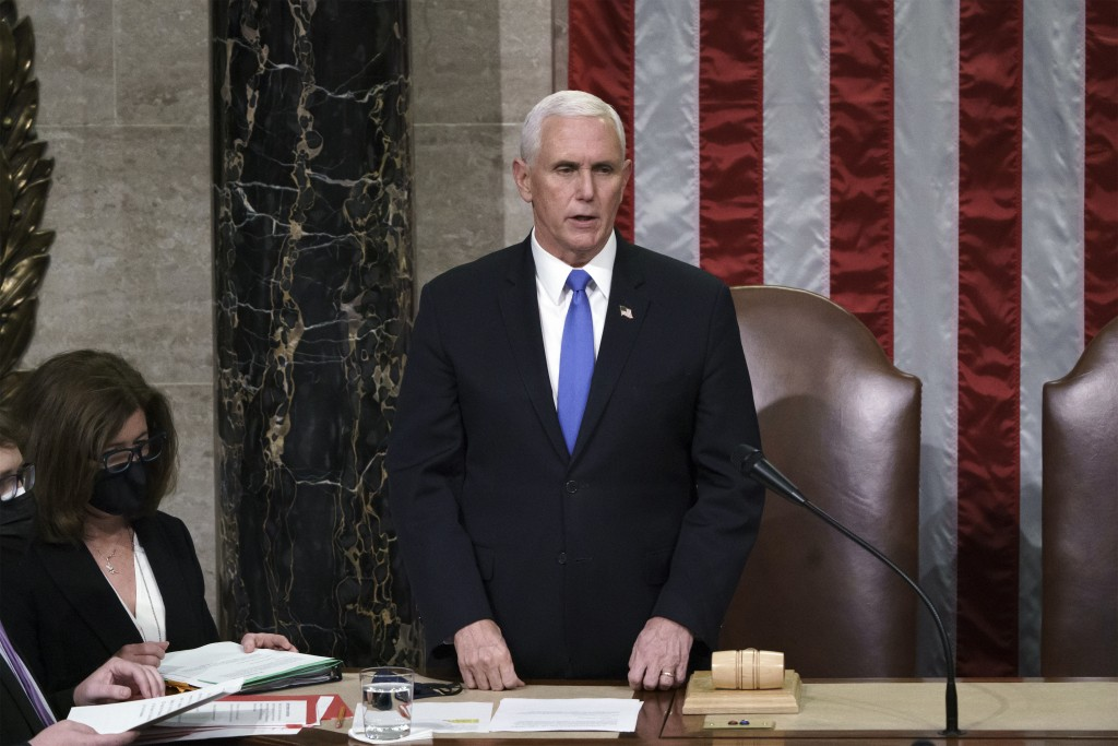 Vice President Mike Pence listens after reading the final certification of Electoral College votes cast in November's presidential election during a j...