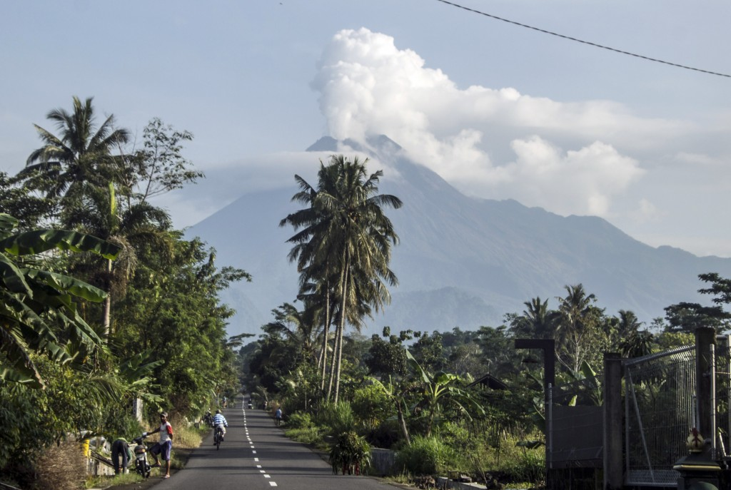 Mount Merapi spews volcanic steam from its crater seen from Sleman, Yogyakarta, Indonesia, Thursday, Jan. 7, 2021. The 2,968-meter (9,737-foot) mounta...