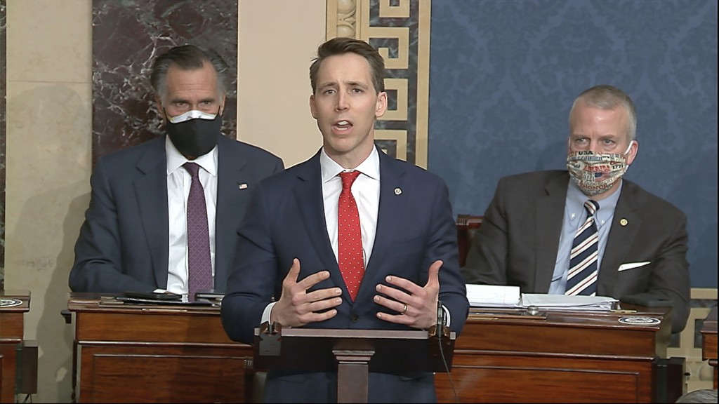 In this image from video, Sen. Josh Hawley, R-Mo., speaks as the Senate reconvenes to debate the objection to confirm the Electoral College Vote from ...