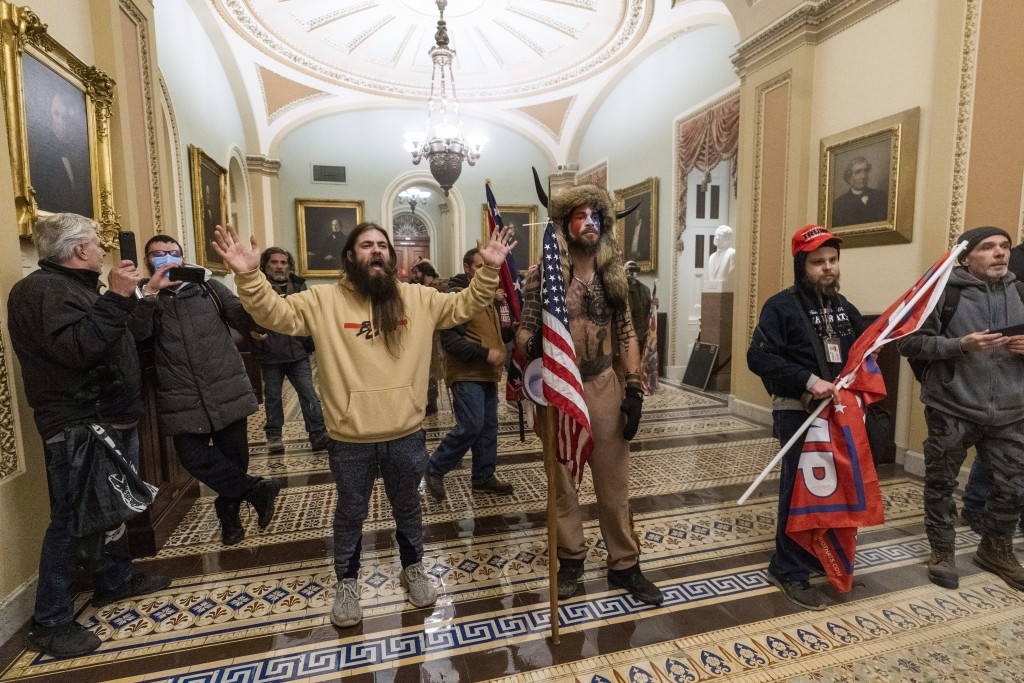 Supporters of President Donald Trump are confronted by U.S. Capitol Police officers outside the Senate Chamber inside the Capitol, Wednesday, Jan. 6, ...