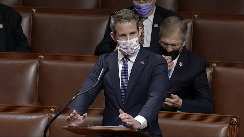 In this image from video, Rep. Adam Kinzinger, R-Ill., speaks as the House debates the objection to confirm the Electoral College vote from Pennsylvan...