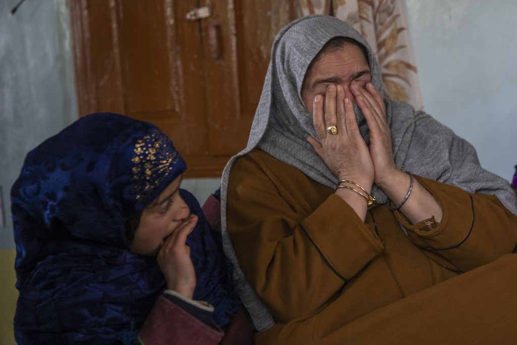 Dilshada Banoo, aunt of 16-year-old Athar Mushtaq, breaks down while talking to Associated Press in Bellow, south of Srinagar, Indian controlled Kashm...