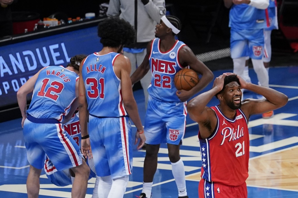 Philadelphia 76ers' Joel Embiid (21) reacts to a foul called on him during the second half of the team's NBA basketball game against the Brooklyn Nets...