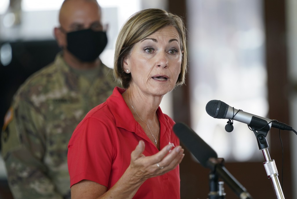 FILE - In this Aug. 14, 2020, file photo, Iowa Gov. Kim Reynolds speaks during a news conference, in Cedar Rapids, Iowa. Reynolds and four top Iowa of...