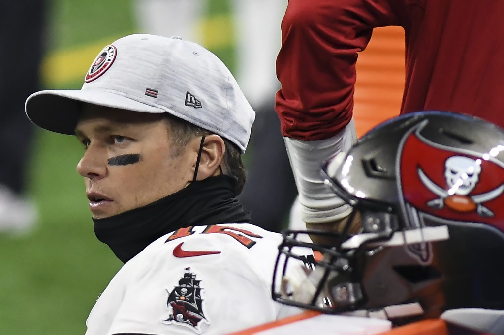 Tampa Bay Buccaneers quarterback Tom Brady sits on the bench during the second half of an NFL football game against the Detroit Lions, Saturday, Dec. ...