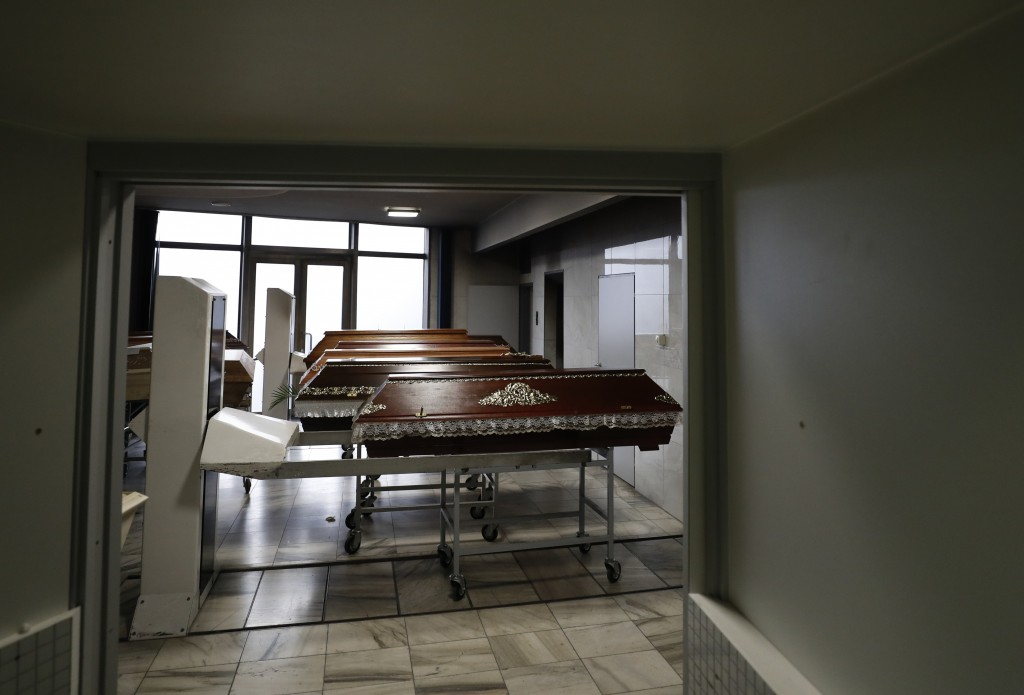 Caskets are prepared to be incinerated at a crematorium in Ostrava, Czech Republic, Thursday, Jan. 7, 2021. The biggest crematorium in the Czech Repub...