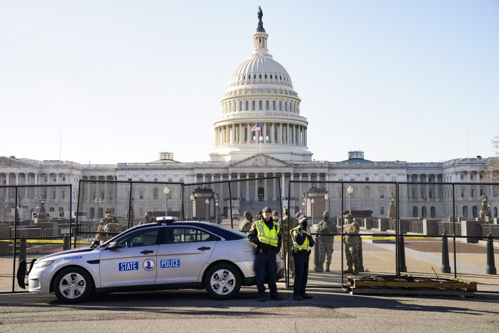Fencing is placed around the exterior of the Capitol grounds, Thursday morning, Jan. 7, 2021 in Washington. The House and Senate certified the Democra...