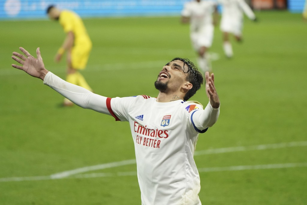 FILE - In this Wednesday, Dec. 23, 2020 file photo, Lyon's Lucas Paqueta celebrates after scoring his sides's third goal during the French League One ...