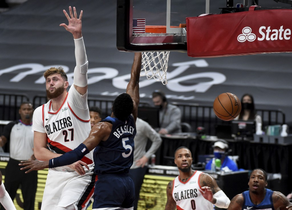 Portland Trail Blazers center Jusuf Nurkic, left, goes up to defend against a shot by Minnesota Timberwolves guard Malik Beasley, right, during the fi...