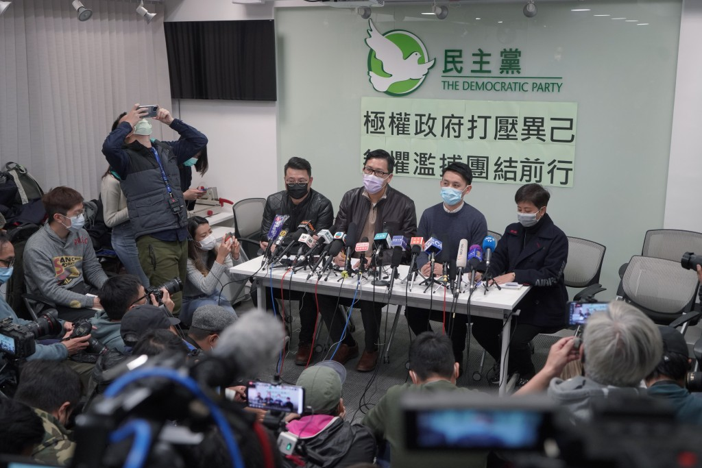 Former Democratic Party legislators Andrew Wan, left, Lam Cheuk-ting, second left, and Helena Wong, right, attend a press conference after being relea...