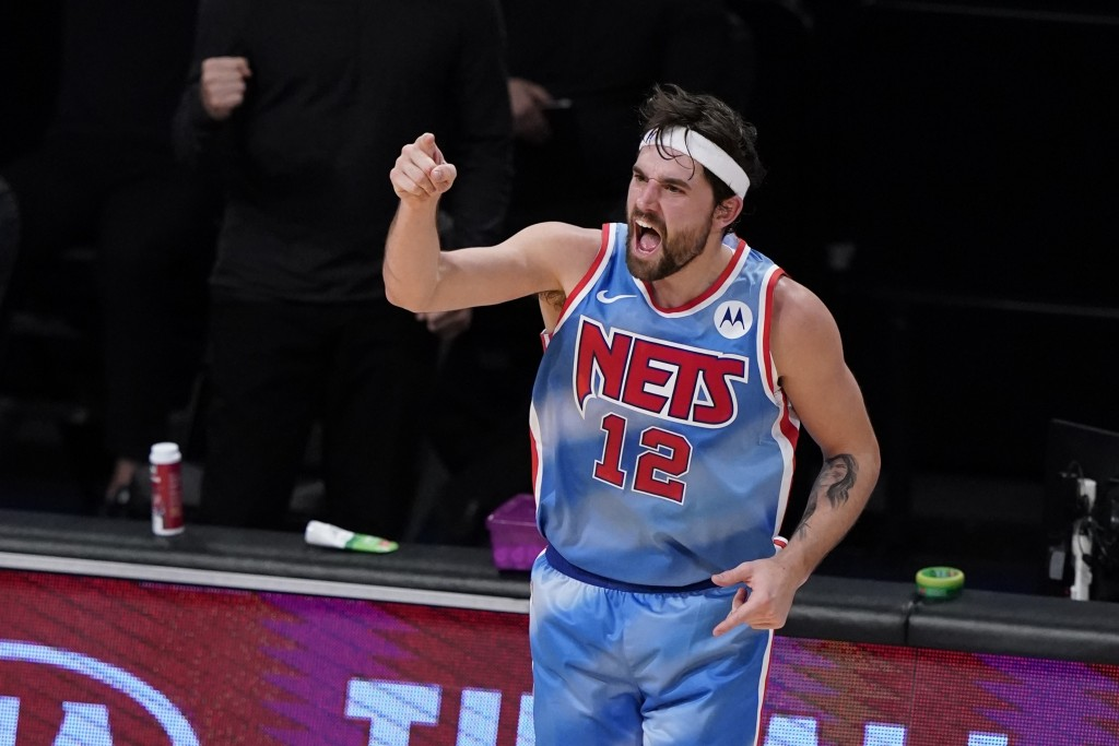 Brooklyn Nets' Joe Harris reacts after making a 3-point basket during the first half of the team's NBA basketball game against the Philadelphia 76ers ...