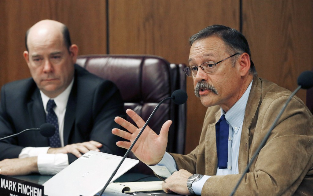FILE - In this Nov. 9, 2015, file photo, Arizona state Rep. Mark Finchem, R-Tucson, right, speaks during a Joint Border Security Advisory Committee at...