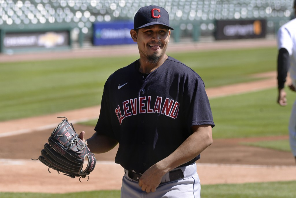 FILE - Cleveland Indians starting pitcher Carlos Carrasco walks to the dugout after striking out Detroit Tigers' Miguel Cabrera in the first inning of...