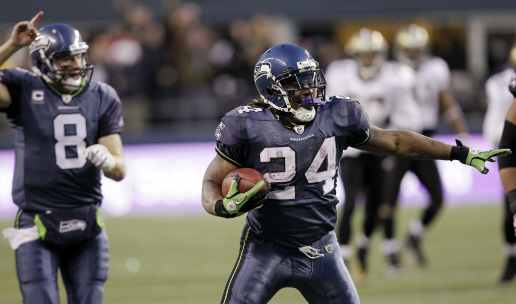 FILE - In this Jan. 8, 2011, file photo, Seattle Seahawks' Marshawn Lynch begins to celebrate on a 67-yard touchdown run against the New Orleans Saint...