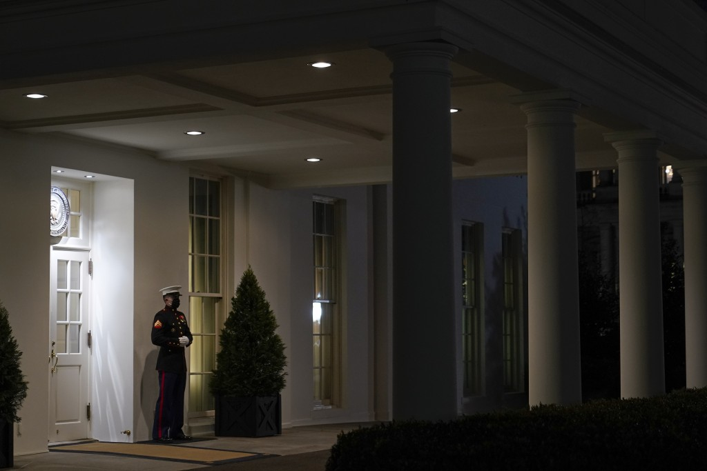 A Marine stands outside the entrance to the West Wing of the White House, signifying President Donald Trump is in the Oval Office, Thursday, Jan. 7, 2...