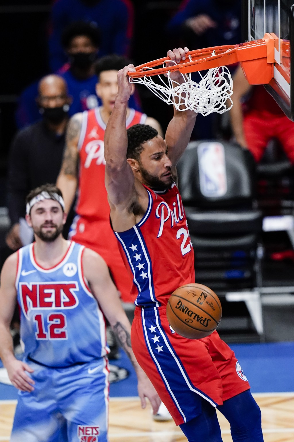 Philadelphia 76ers' Ben Simmons dunks in front of Brooklyn Nets' Joe Harris during the first half of an NBA basketball game Thursday, Jan. 7, 2021, in...