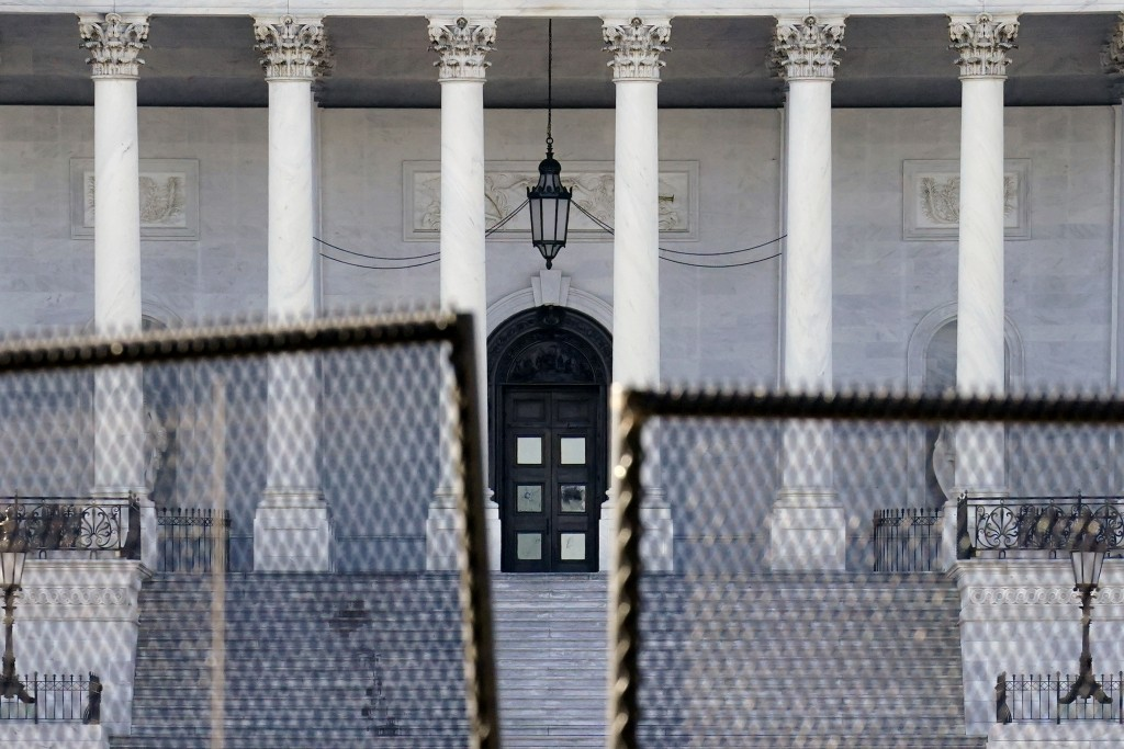 Fencing is placed around the exterior of the Capitol grounds, Thursday, Jan. 7, 2021 in Washington. The House and Senate certified the Democrat's elec...