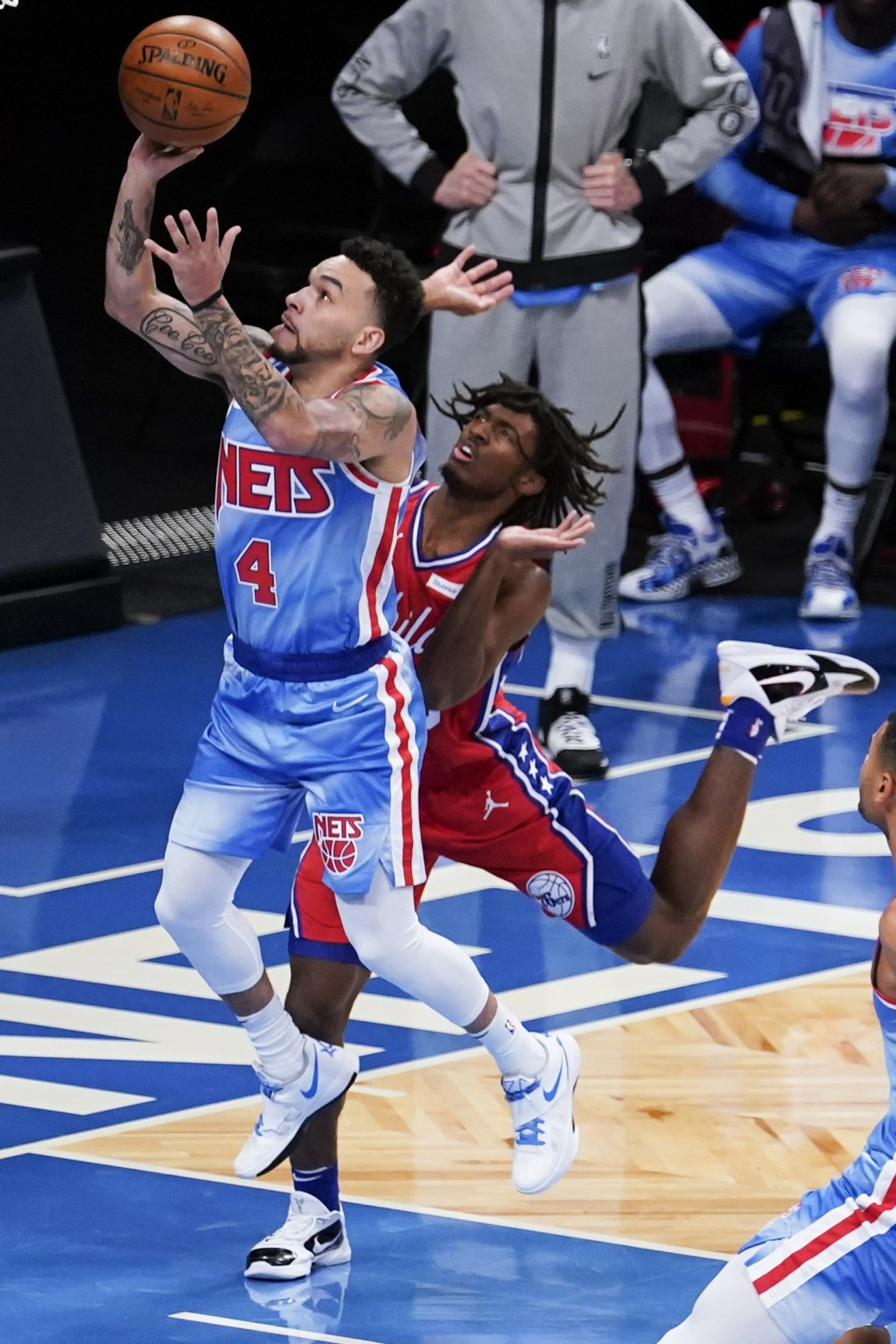 Brooklyn Nets' Chris Chiozza, left, drives past Philadelphia 76ers' Tyrese Maxey during the first half of an NBA basketball game Thursday, Jan. 7, 202...