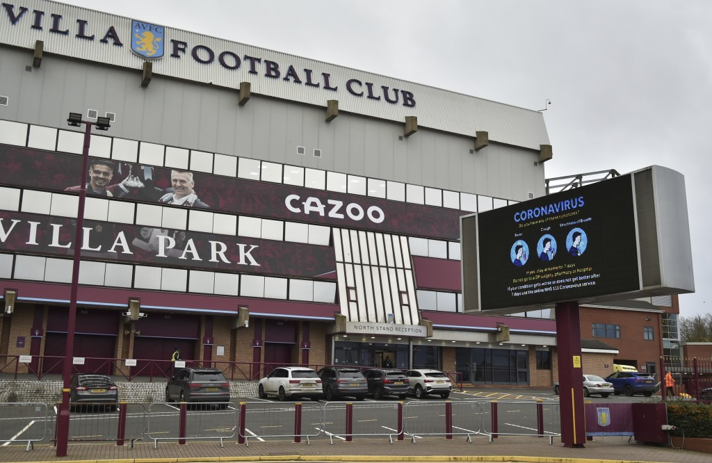 FILE - This Saturday, Nov. 21, 2020 file photo shows a general view of a social distancing message on display outside the Villa Park stadium, home of ...