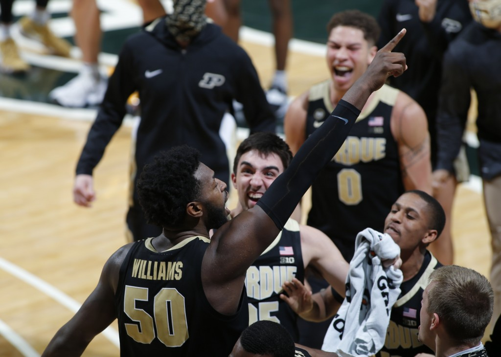 Purdue's Trevion Williams, left, celebrates with teammates following an NCAA college basketball game against Michigan State, Friday, Jan. 8, 2021, in ...