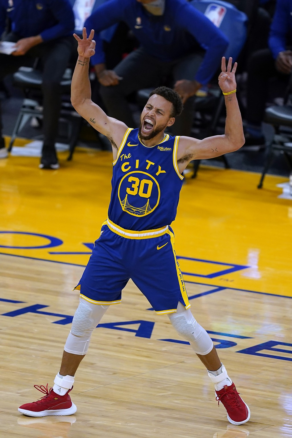 Golden State Warriors guard Stephen Curry celebrates after Andrew Wiggins made a 3-point shot against the Los Angeles Clippers during the second half ...