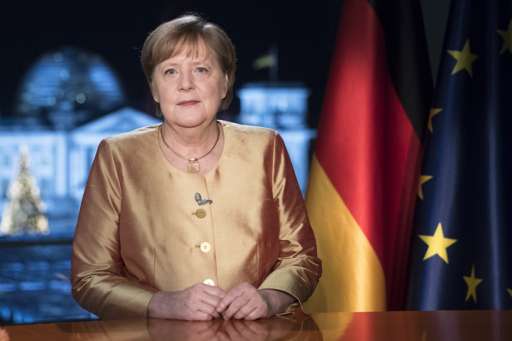 FILE - In this Dec. 30, 2020 file photo German Chancellor Angela Merkel poses for photographs after the television recording of her annual New Year's ...
