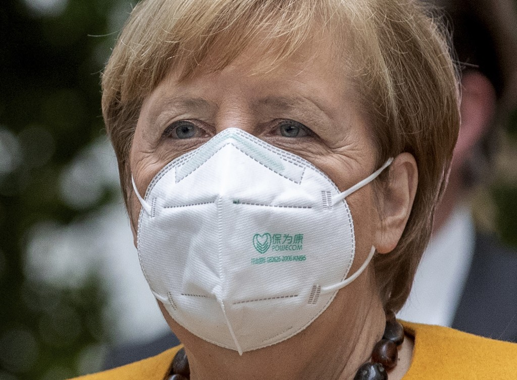 File - File picture taken Nov.2, 2020 shows German Chancellor Angela Merkel arriving for a press conference in Berlin, Germany. The coronavirus pandem...