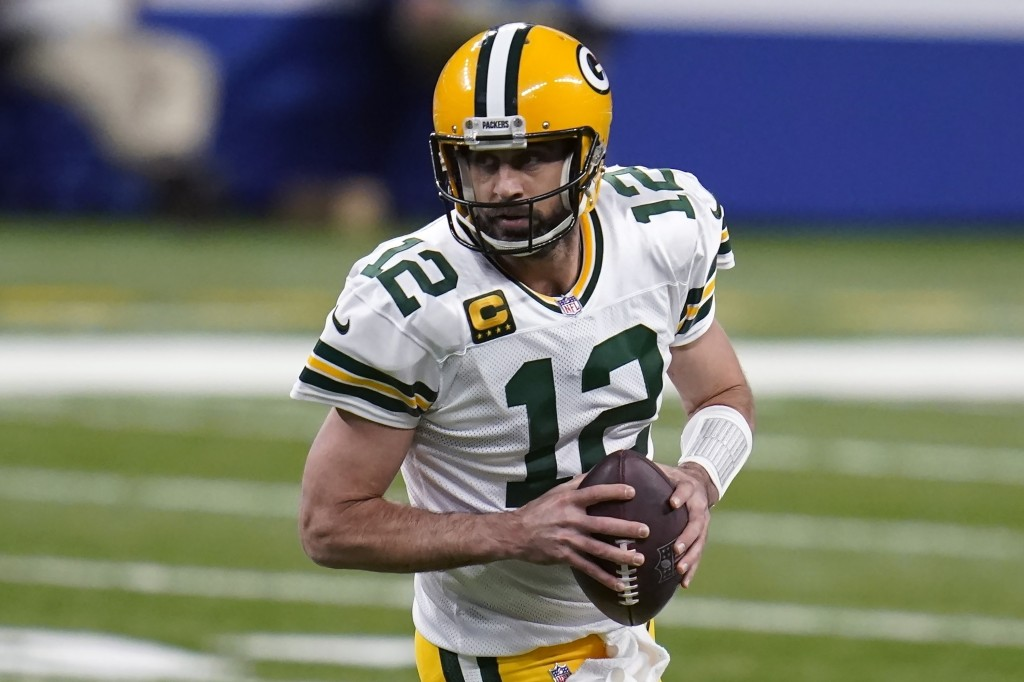 FILE - Green Bay Packers quarterback Aaron Rodgers looks to throw during the first half of an NFL football game against the Indianapolis Colts in Indi...