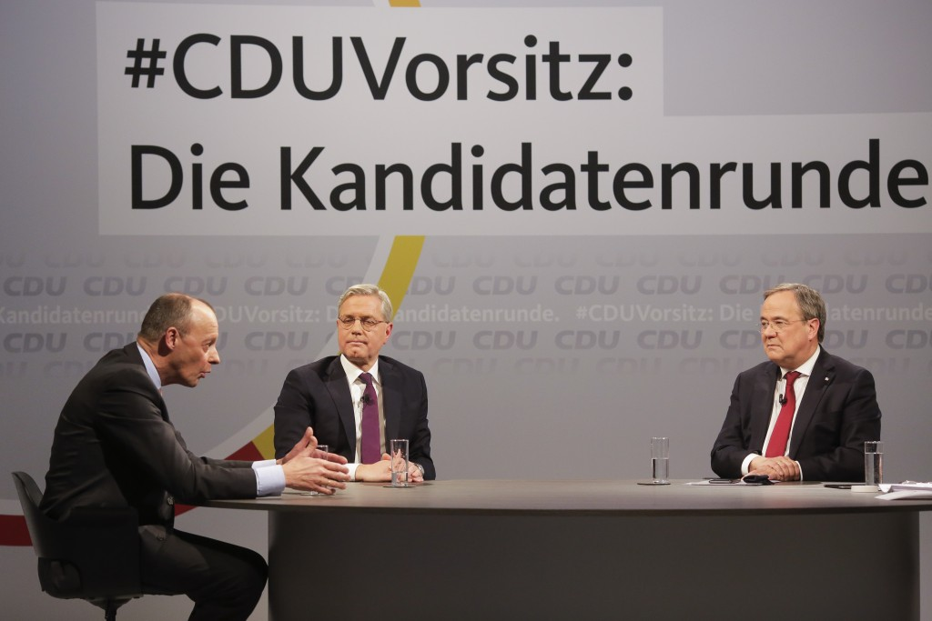 FILE - In this Dec. 14, 2020 file photo, the three candidates for the chairmanship of the Christian Democratic Union party, CDU, Friedrich Merz, left,...