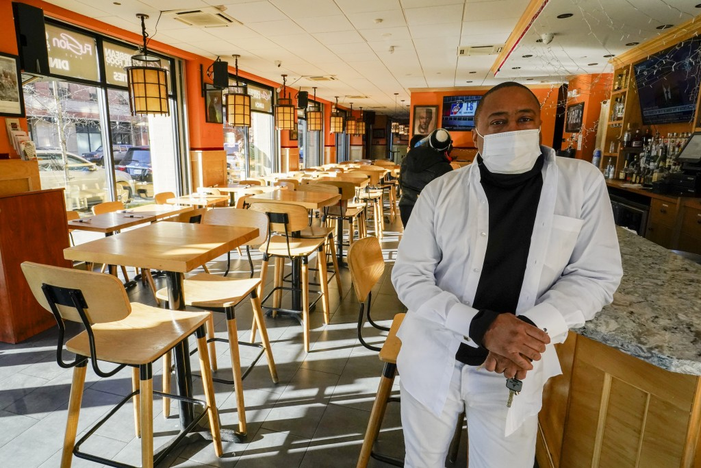 Andrew Walcott, owners of Fusion East Caribbean & Soul Food restaurant, poses for a photo at the restaurant in East New York neighborhood of the Brook...