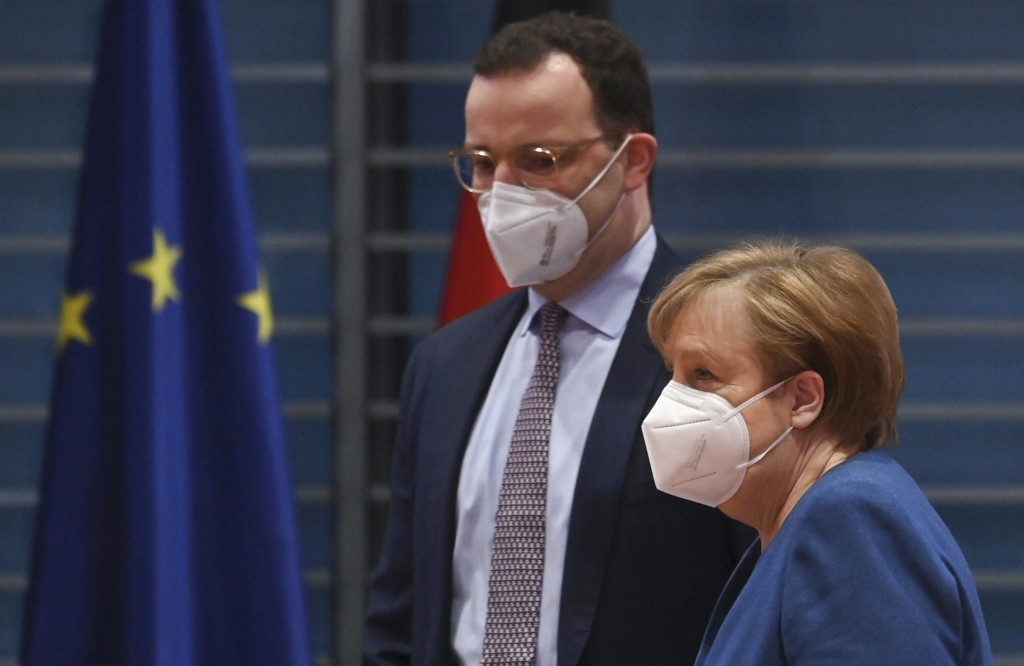 FILE - In this Jan. 6, 2021 file photo, German Chancellor Angela Merkel and Federal Health Minister Jens Spahn  arrive at the weekly cabinet meeting w...