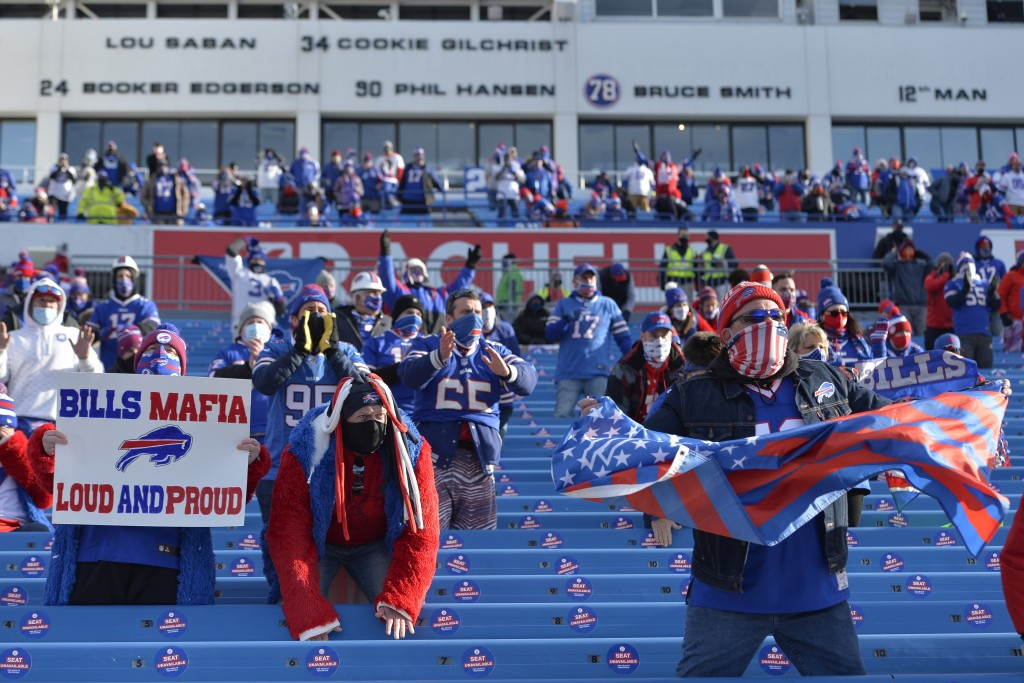 Buffalo Bills fans cheer during the first half of an NFL wild-card playoff football game against the Indianapolis Colts, Saturday, Jan. 9, 2021, in Or...