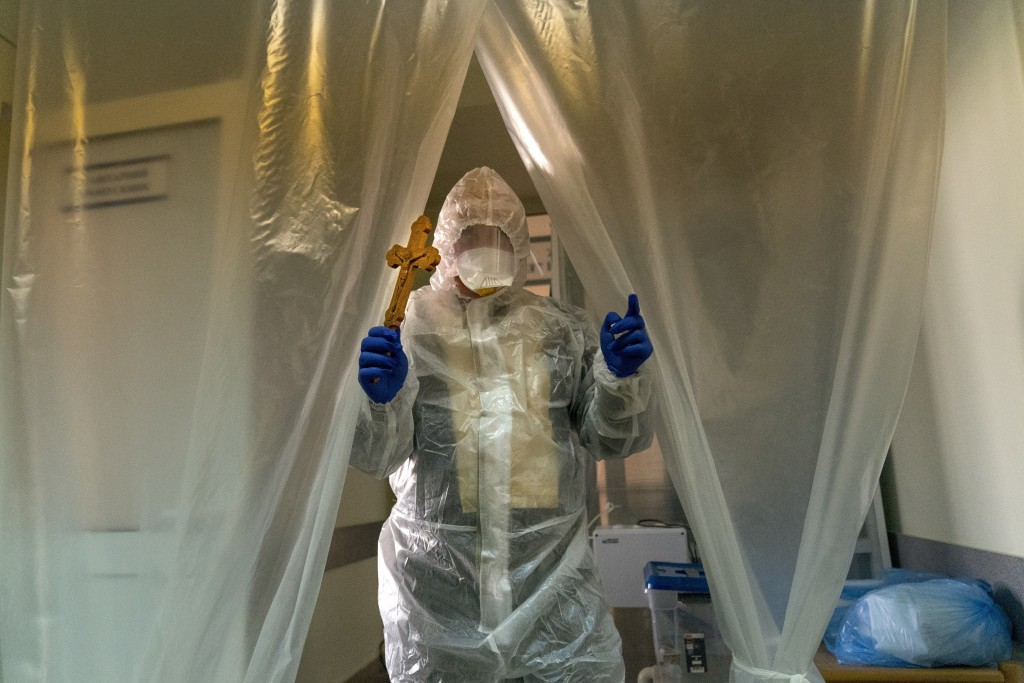 Father Stephan, Ukrainian Greek Catholic Church priest, wearing a special suit to protect himself against coronavirus enters an intensive care unit of...