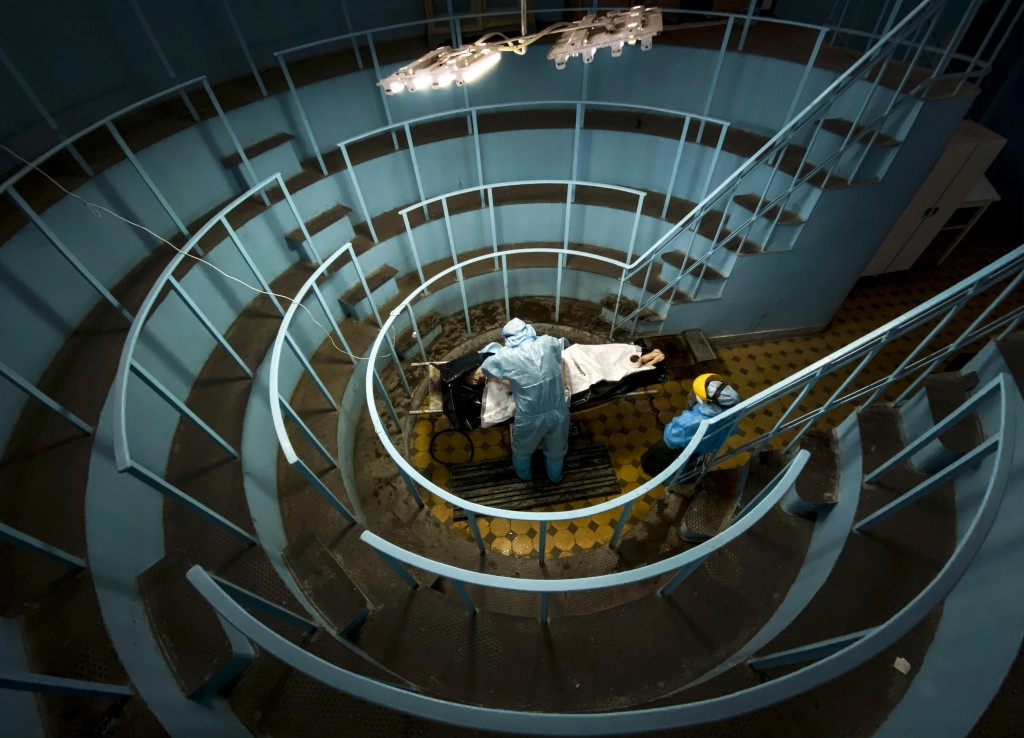 A pathologist conducts an autopsy in an anatomical theater at the Lviv National Medical University in Lviv, Western Ukraine, on Tuesday, Jan. 5, 2021....