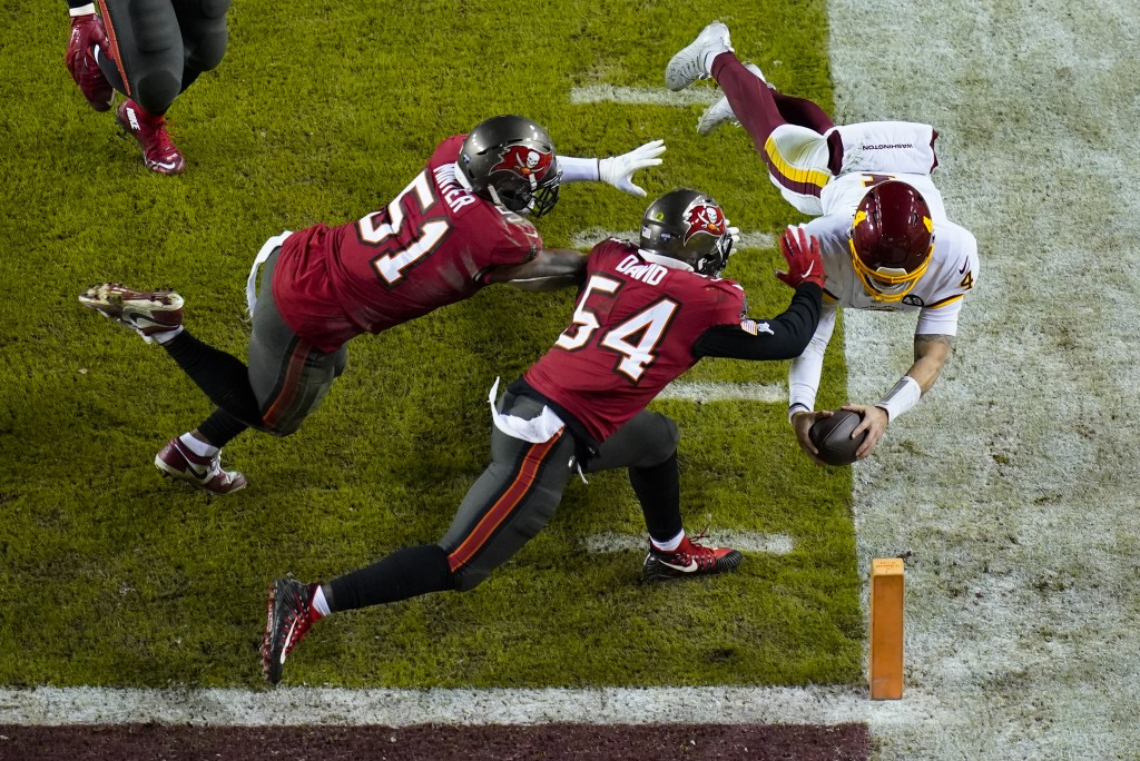 Washington Football Team quarterback Taylor Heinicke (4) dives toward the end zone to score a touchdown against Tampa Bay Buccaneers inside linebacker...