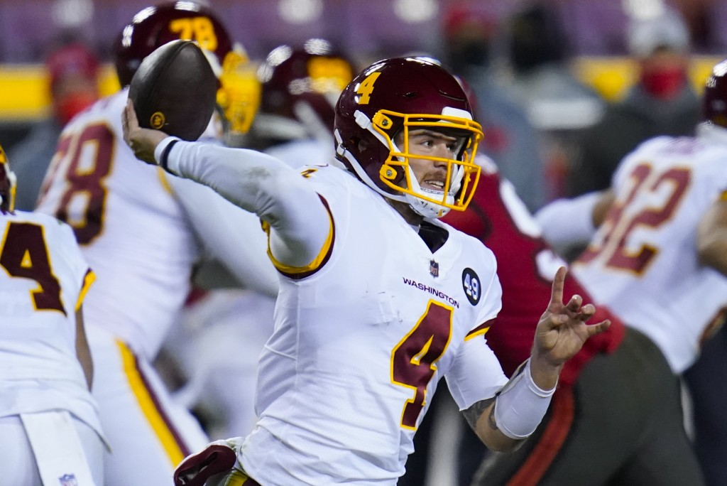 Washington Football Team quarterback Taylor Heinicke (4) throws a pass during the first half of an NFL wild-card playoff football game against the Tam...