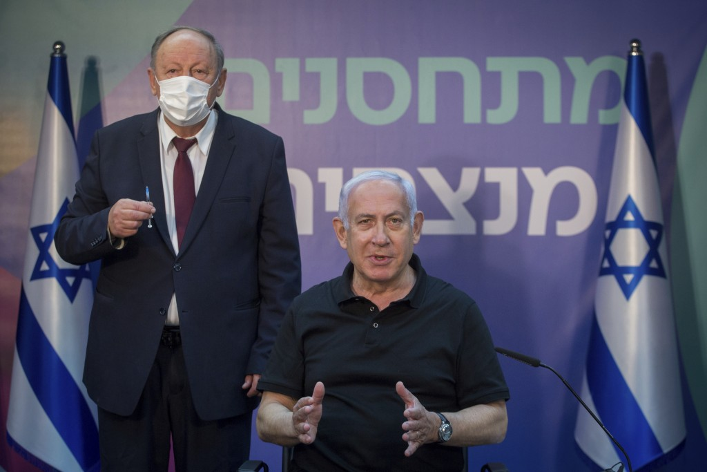 Israeli Prime Minister Minister Benjamin Netanyahu speaks to the media before receiving second Pfizer-BioNTech COVID-19 vaccine at Sheba Medical Cente...