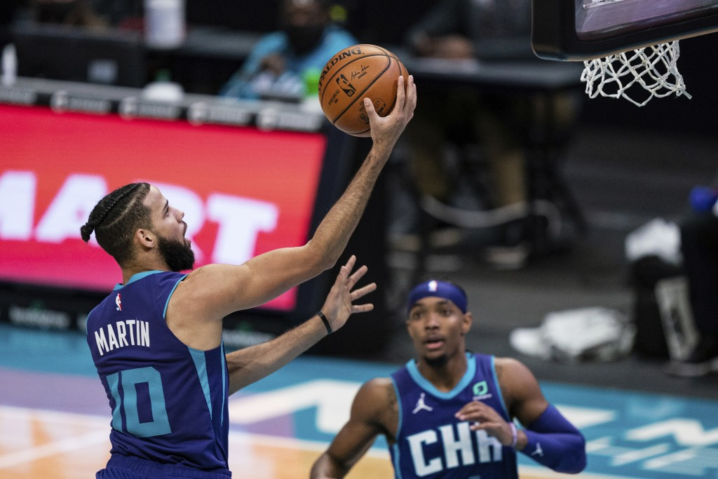 Charlotte Hornets forward Caleb Martin (10) lays up the ball during the second half of the team's NBA basketball game against the Atlanta Hawks in Cha...