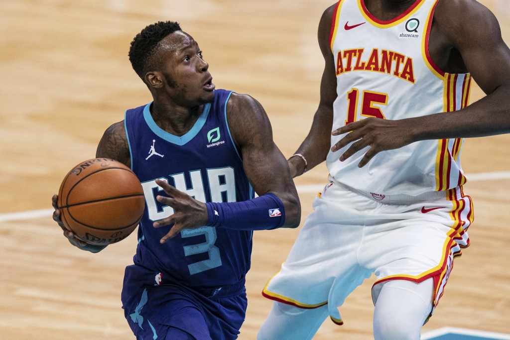 Charlotte Hornets guard Terry Rozier (3) drives past Atlanta Hawks center Clint Capela (15) during the second half of an NBA basketball game in Charlo...