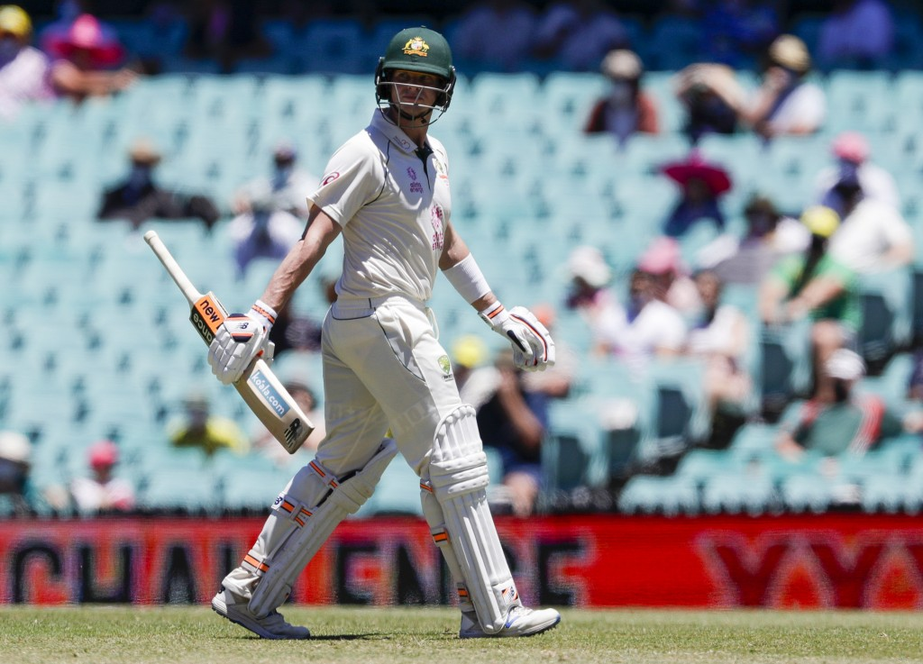 Australia's Steve Smith walks from the field after he was dismissed on 81 runs during play on day four of the third cricket test between India and Aus...