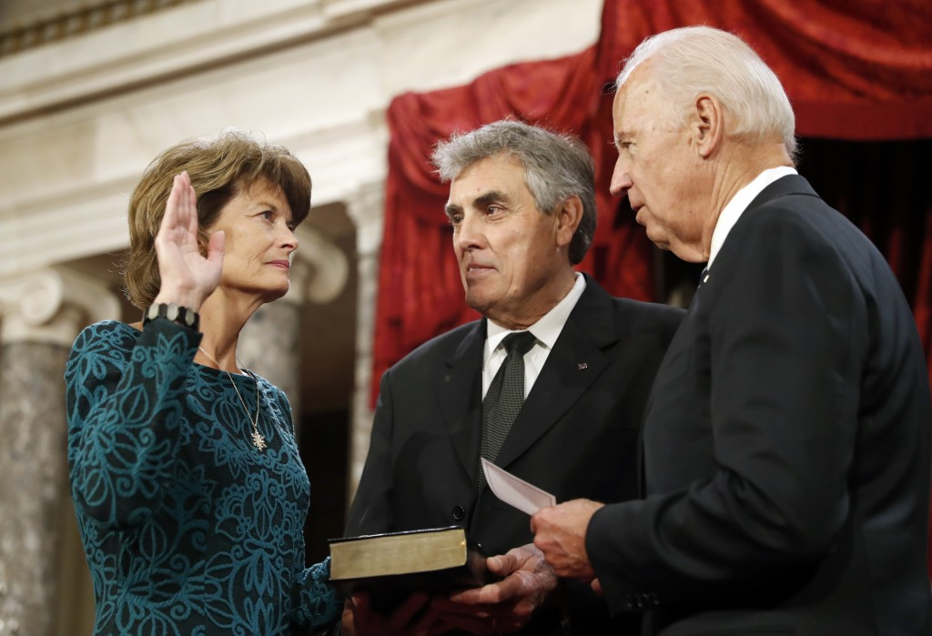FILE - In this Jan. 3, 2017, file photo, Vice President Joe Biden, right, after administers the Senate oath of office to Sen. Lisa Murkowski, R-Alaska...