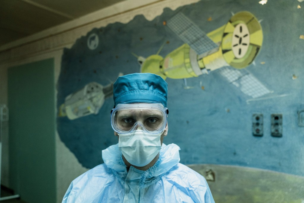Ruslan Kushnir, medical worker, wearing a special suit to protect himself against coronavirus stands ready to meet a new patient with COVID-19 in a ho...