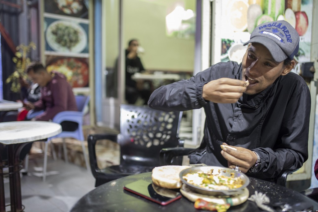 A man eats, in a restaurant in central Dakhla, Western Sahara, Monday, Dec. 21, 2020. U.S. plans to open a consulate in Western Sahara mark a turning ...