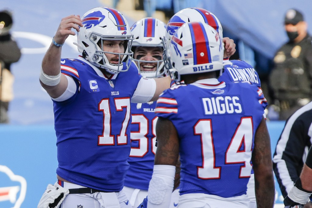 Buffalo Bills' Josh Allen (17) celebrates with teammate Stefon Diggs (14) after scoring a touchdown during the first half of an NFL wild-card playoff ...