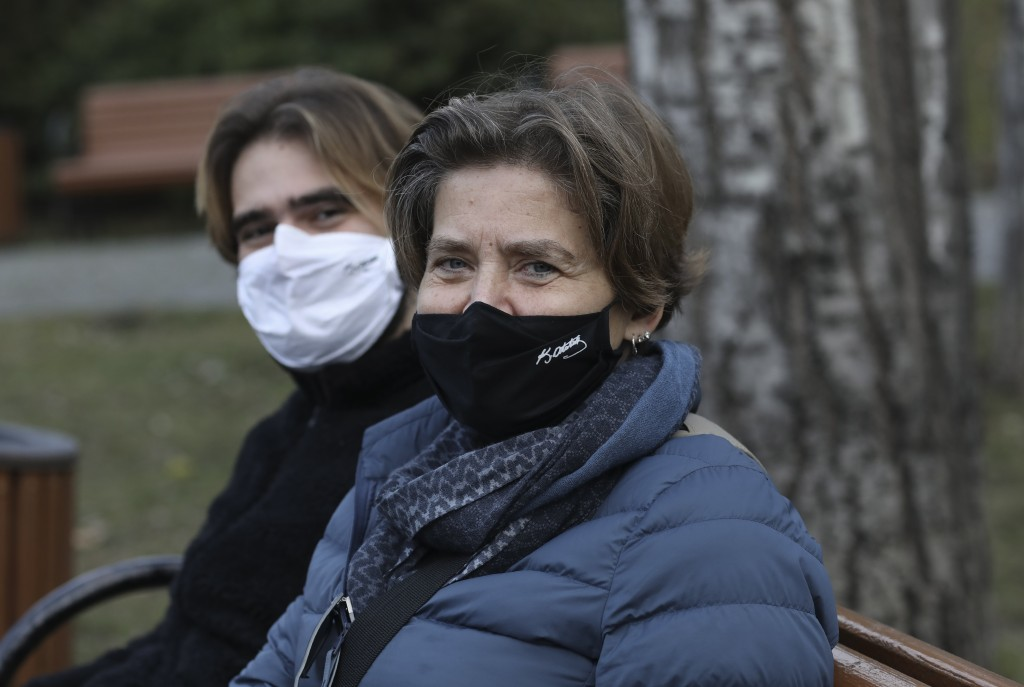 A Turkish mother and her son wearing masks with the signatures of Turkey's founder Mustafa Kemal Ataturk to help protect against the spread of coronav...