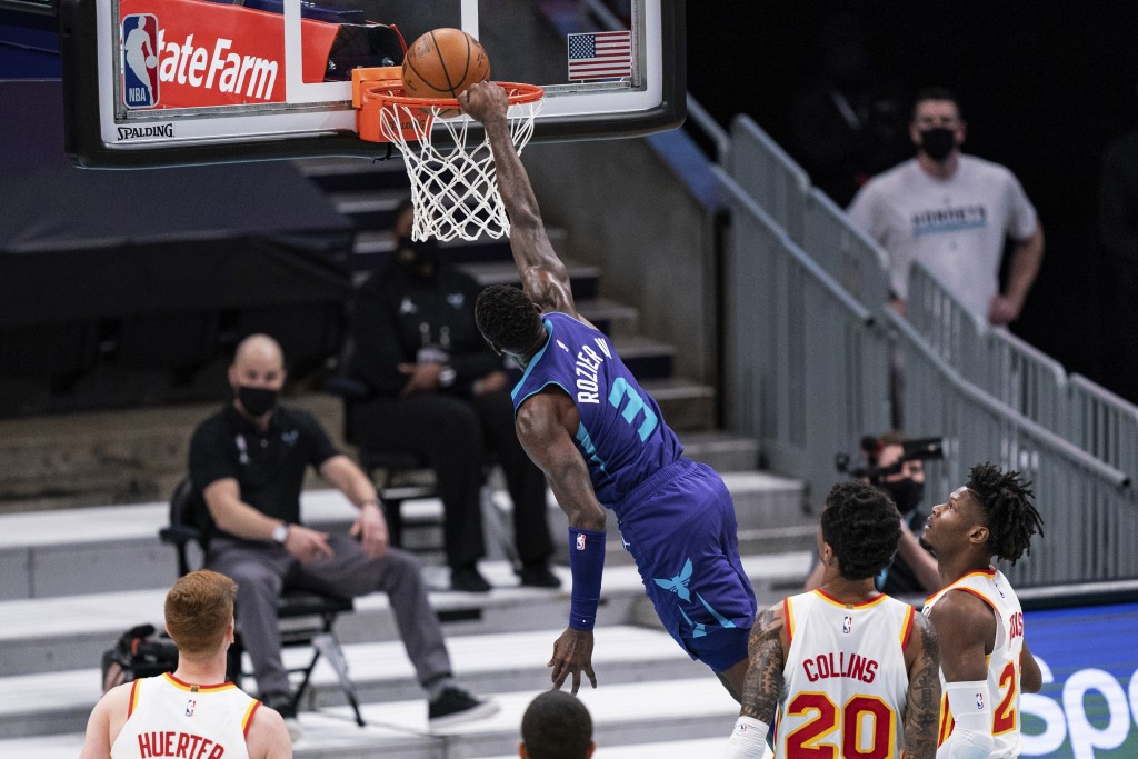 Charlotte Hornets guard Terry Rozier (3) dunks against the Atlanta Hawks during the first half of an NBA basketball game in Charlotte, N.C., Saturday,...