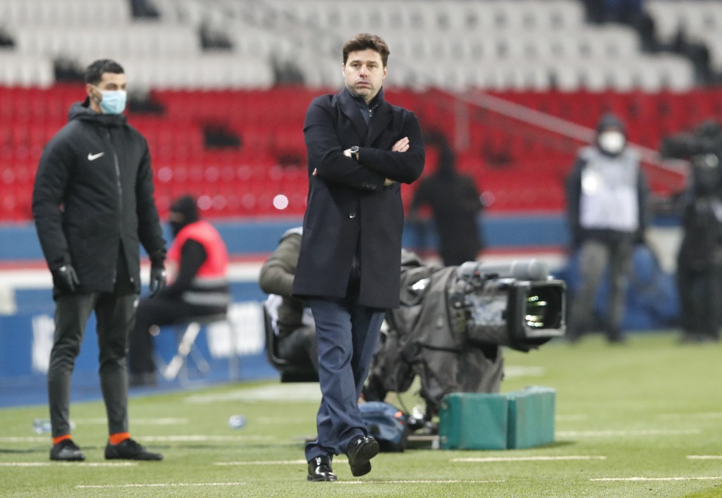 PSG's head coach Mauricio Pochettino stands on the touchline during the French League One soccer match between Paris Saint-Germain and Brest at the Pa...