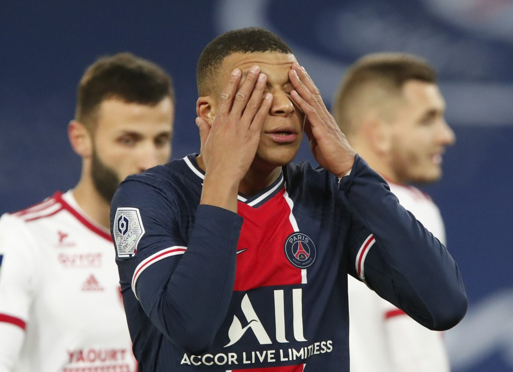 PSG's Kylian Mbappe reacts after missing a chance during the French League One soccer match between Paris Saint-Germain and Brest at the Parc des Prin...