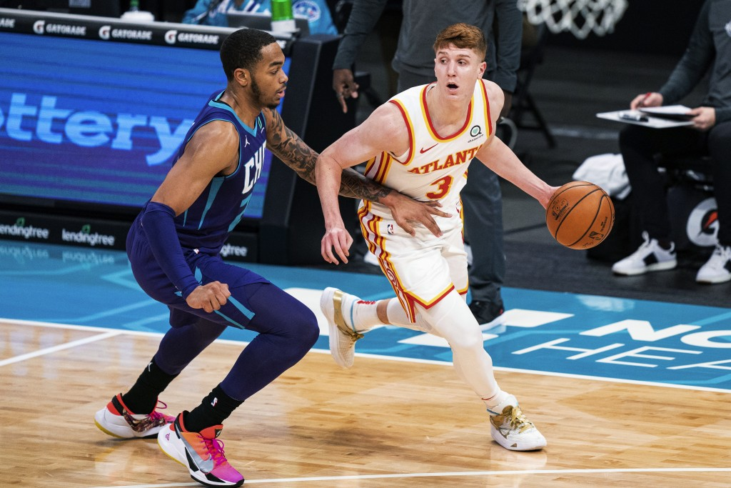 Atlanta Hawks guard Kevin Huerter (3) is guarded by Charlotte Hornets forward P.J. Washington during the first half of an NBA basketball game in Charl...